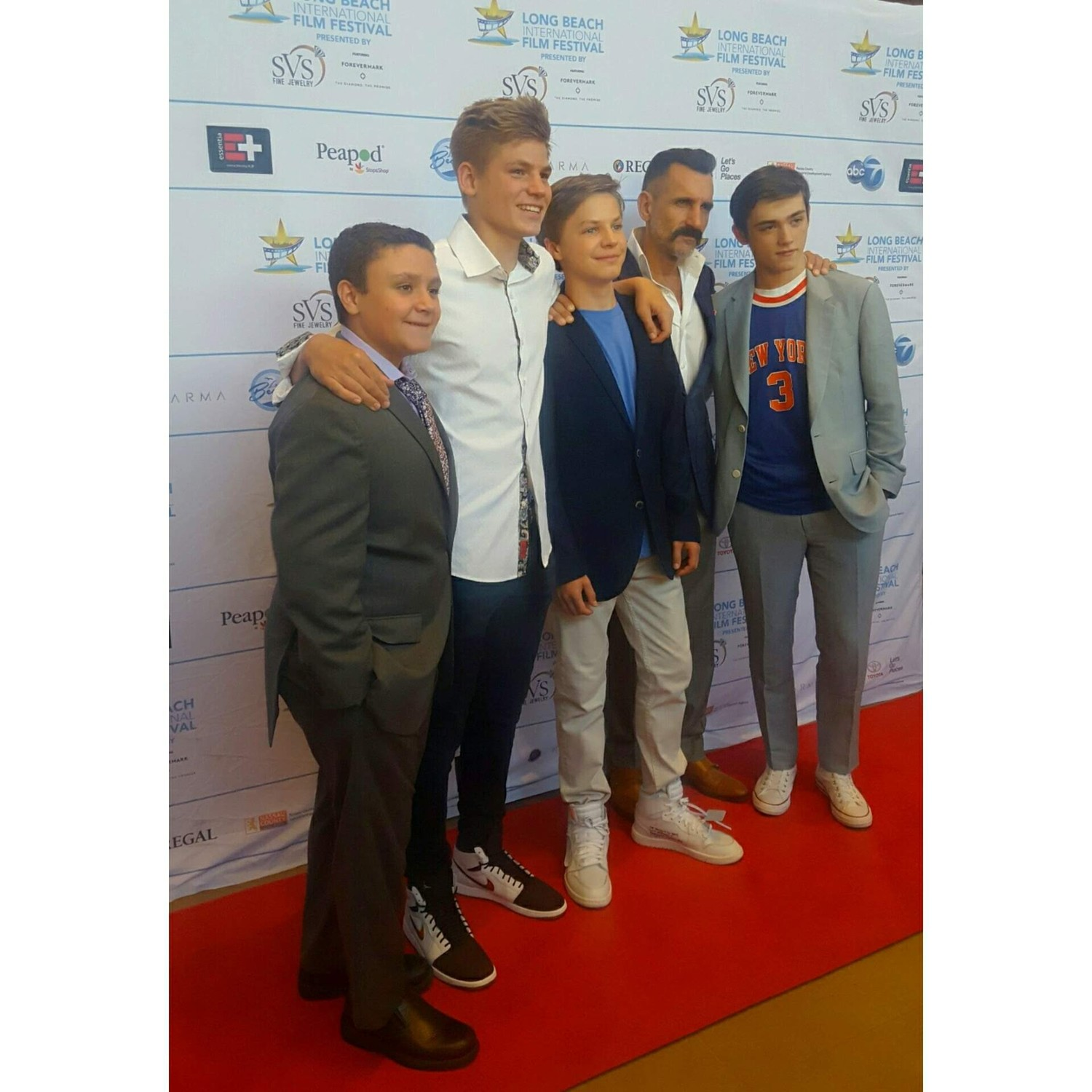 Cast members James DiGiacomo, far left, Harrison Wittmeyer, Tanner Flood, Wass Stevens and Sellati on the red carpet in Lynbrook.