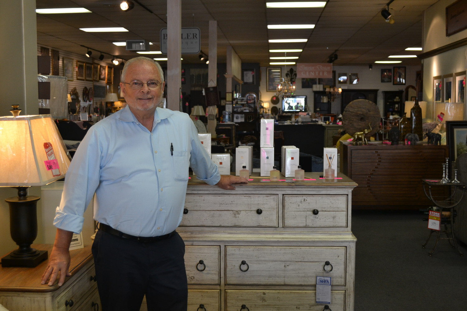 Store owner Brian Mercadante standing proudly in the store he has run for 28 years in Glen Cove.