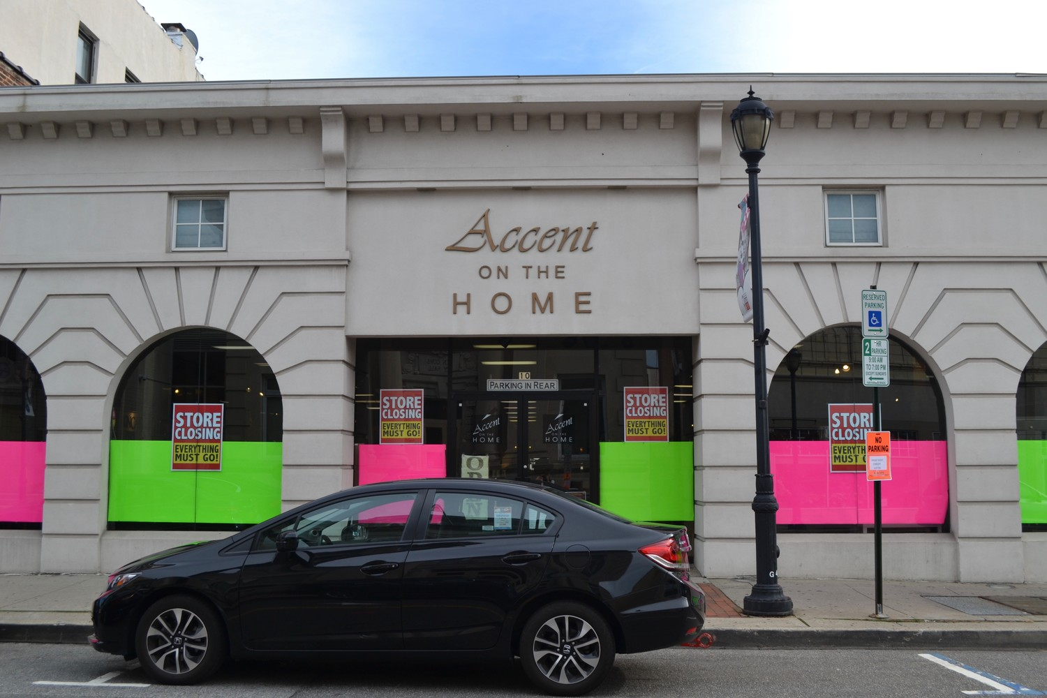 Accent on the Home storefront displayed their closing announcement and sale signs.