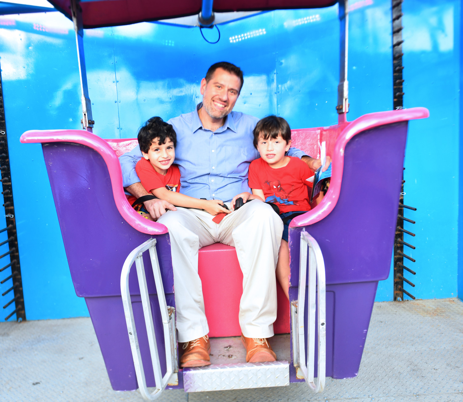The Romito family, from left, Antonio, Anthony and Francesco, took a ride on the Ferris wheel.