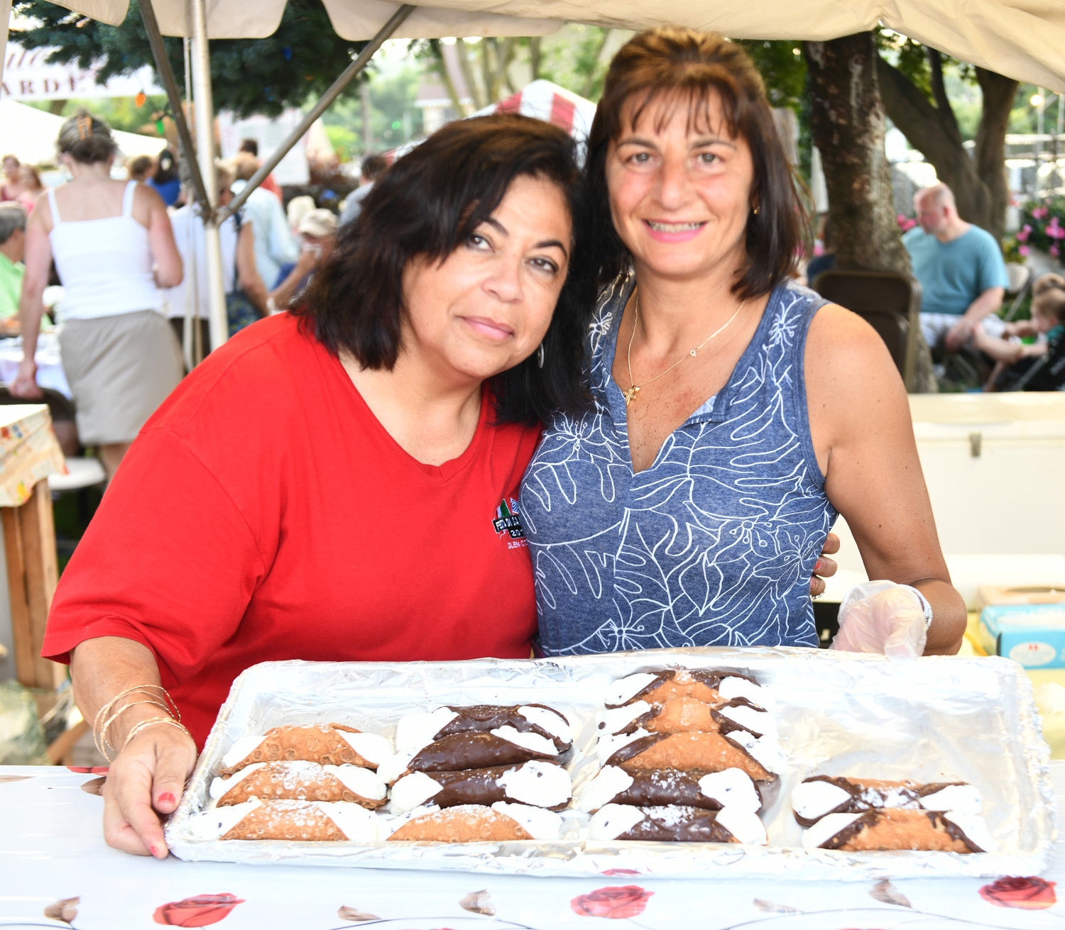 """Canolis, anyone?"" Maria Roberto and Francine Santoro, far left, asked the crowd."