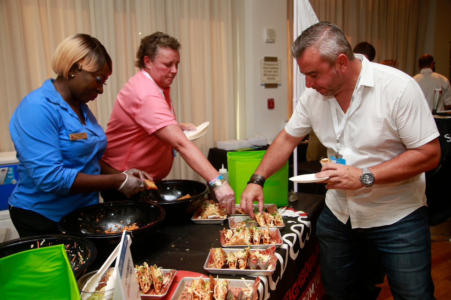 Applebee's General Manager Patricia Erskine and Carla Heyliger offered Frank Lavacca chicken wonton tacos.