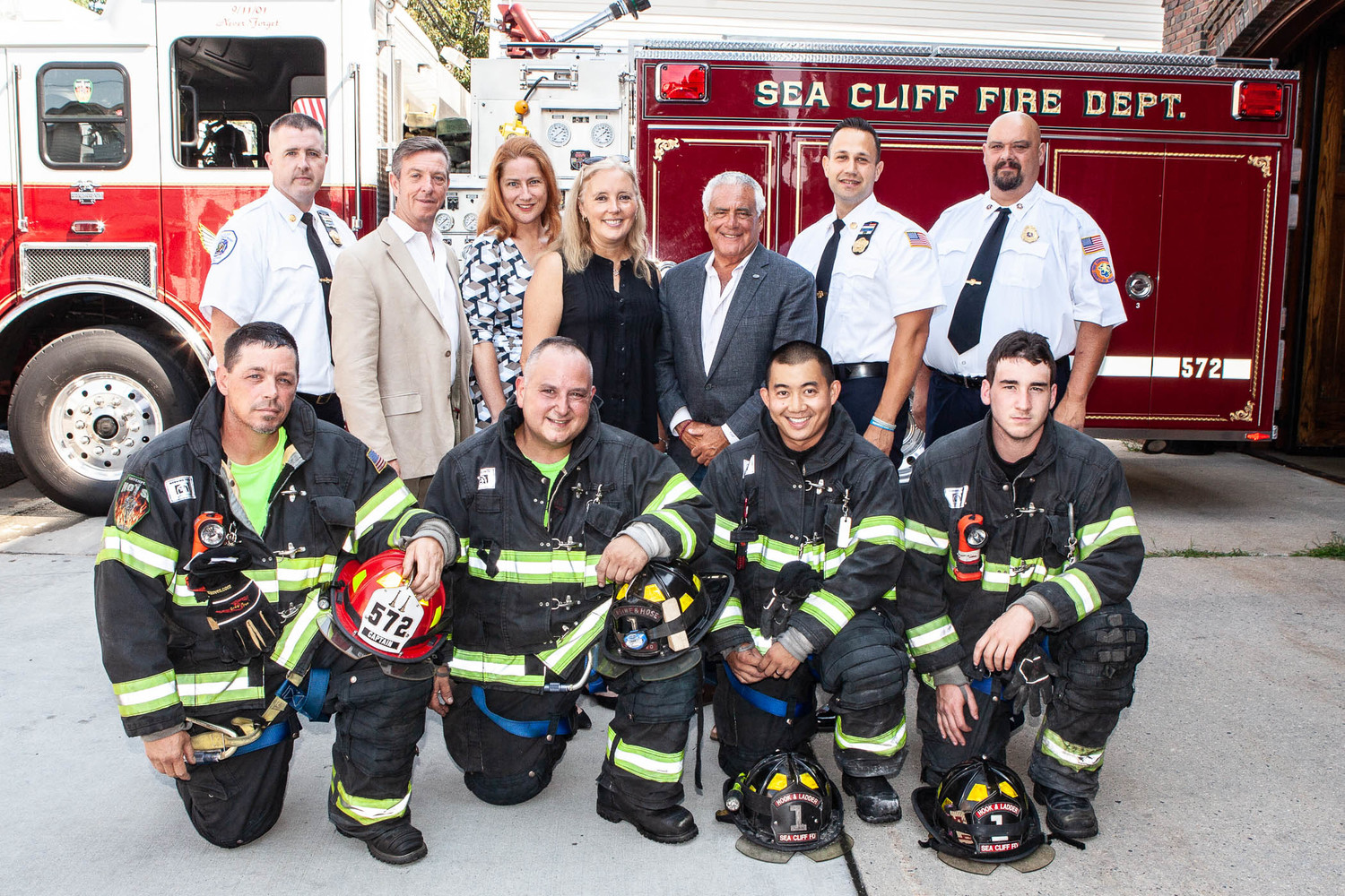 Legislator Delia DeRiggi-Whitton, center, with village officials and some of Sea Cliff's finest.