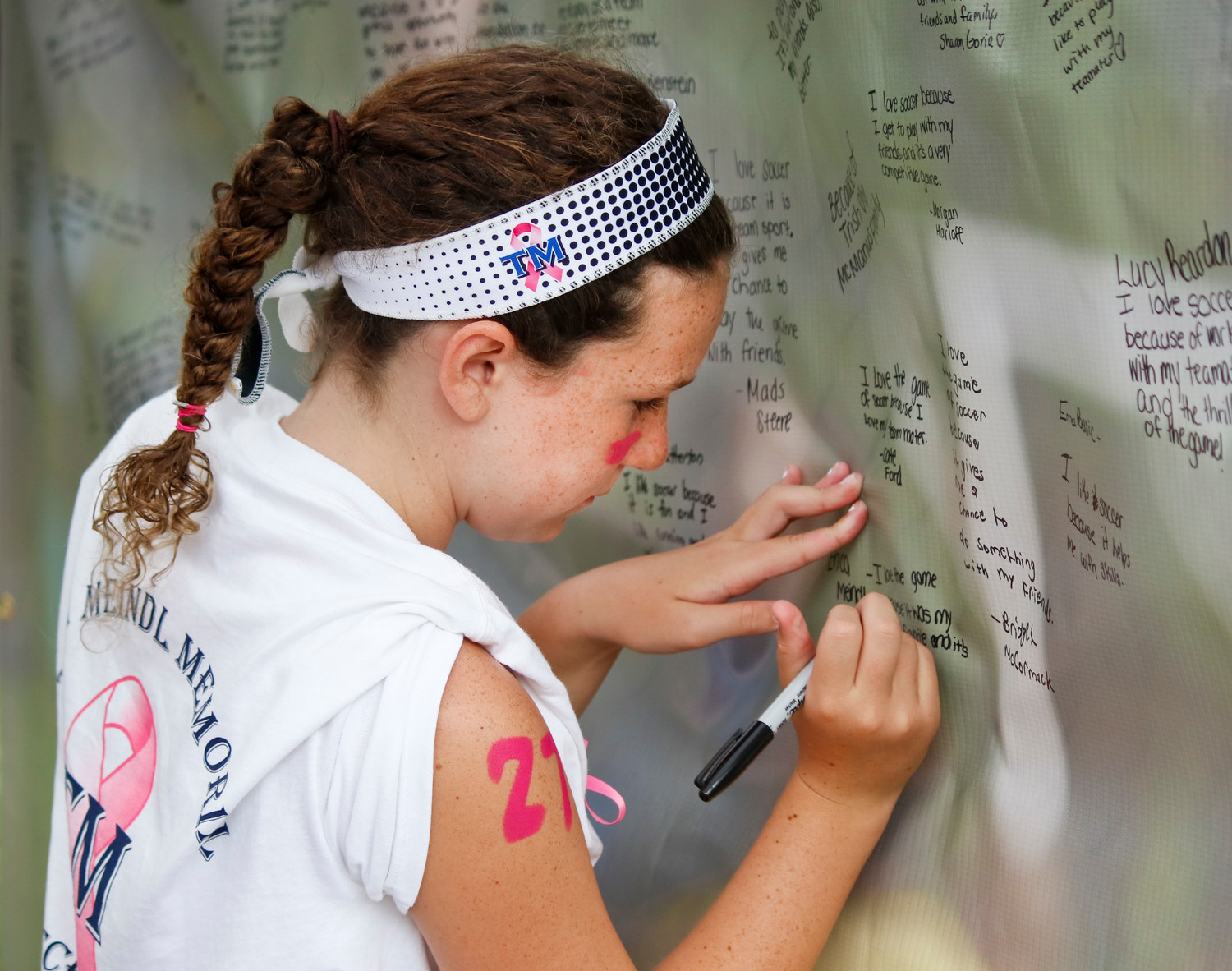 """I love the game because it was my mom's favorite, and it's my favorite sport too,"" Erica Meindl wrote on the ""Why I Love the Game"" banner."