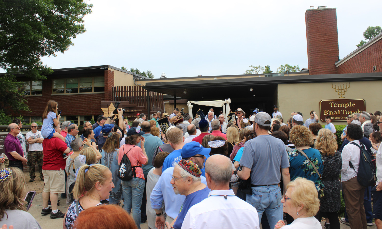 Temple Emanu-El closed its doors on June 10, after nearly 200 congregants marched 3.8 miles in the heat to Temple B'Nai Torah in Wantagh.