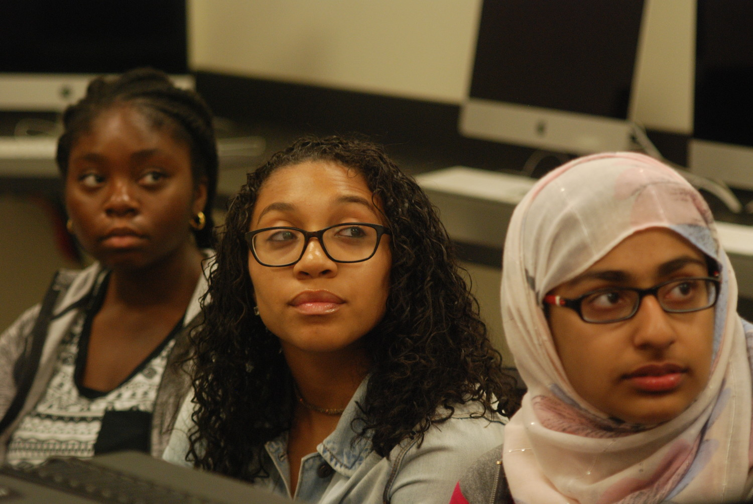 Abimbola Omotade, of Elmont, Maya Brown, of Freeport, and Laila Choudhry, Elmont High School 2018 salutatorian, were among the 10 participants in Hofstra's recent High School Summer Journalism Institute. They were shown above during a photography class.