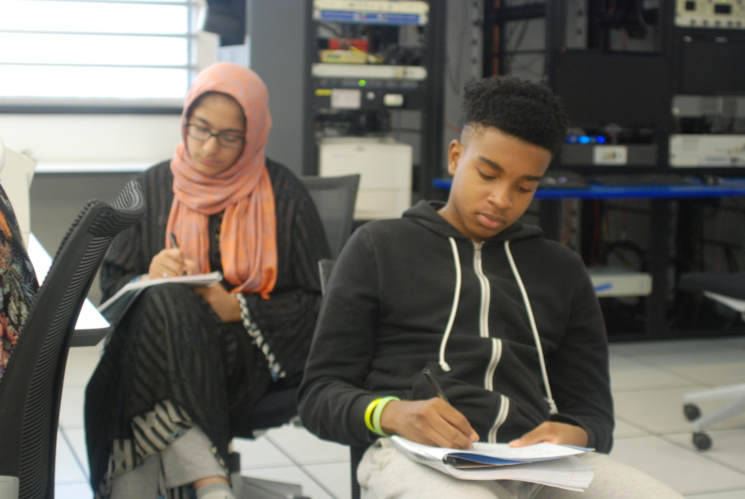 Momna Choudhry, left, and Andrew Candio, both Elmont High School sophomores, hard at work at the Hofstra University High School Summer Journalism Institute.
