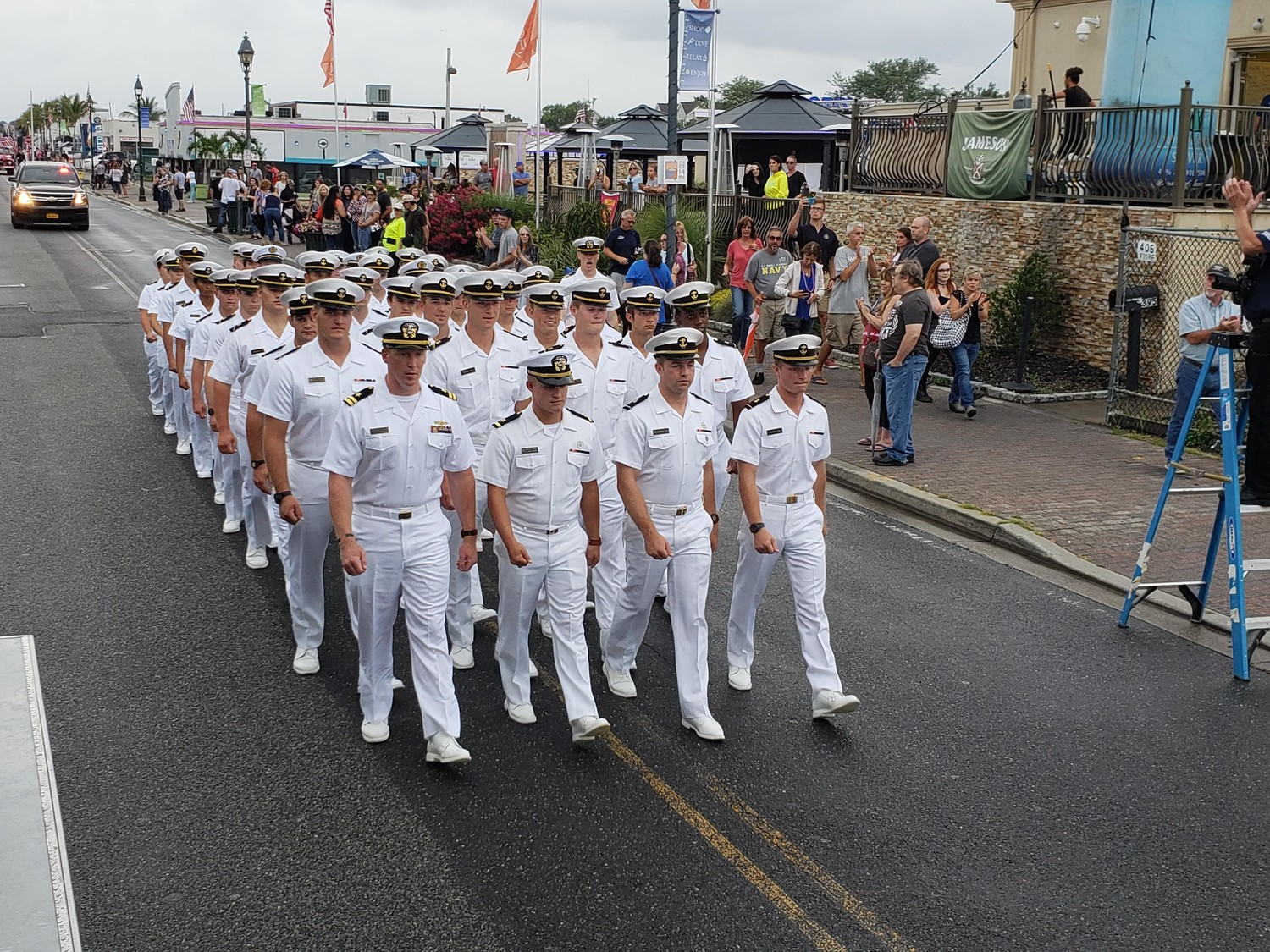 While the U.S. Naval Academy midshipmen spent a weekend celebrating 20 years of visiting Freeport, they dressed in their white summer uniforms and marched in the 125th anniversary parade to commemorate the Freeport Fire Department on Aug. 11.