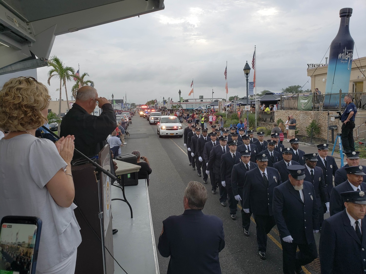Freeport Mayor Robert Kennedy saluted the Freeport Fire Department during its 125th anniversary parade on Aug. 11.