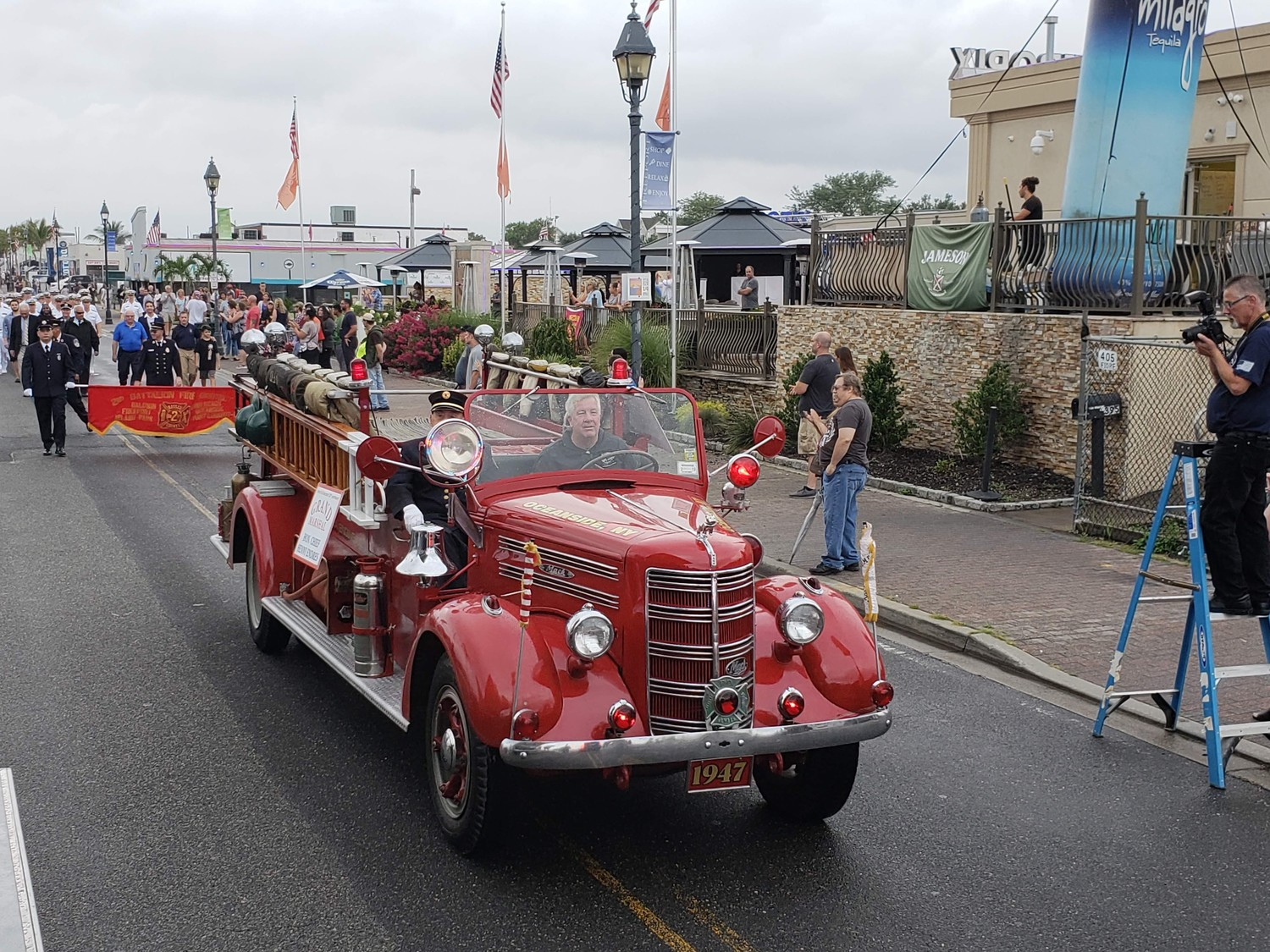 Participating in and supporting Freeport's celebration, the Oceanside Fire Department cruised down Woodcleft Avenue with the parade's grand marshal, Chief Henny Enders, in an antique fire truck.