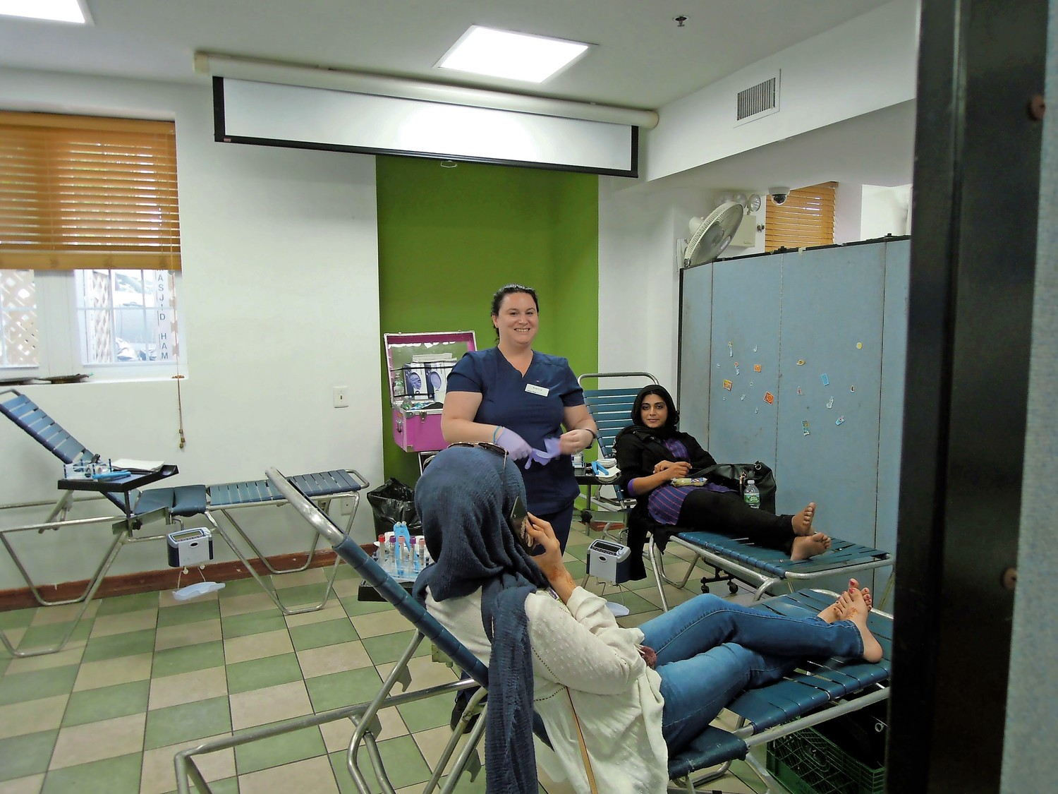 Women relaxed with a snack after donating blood.