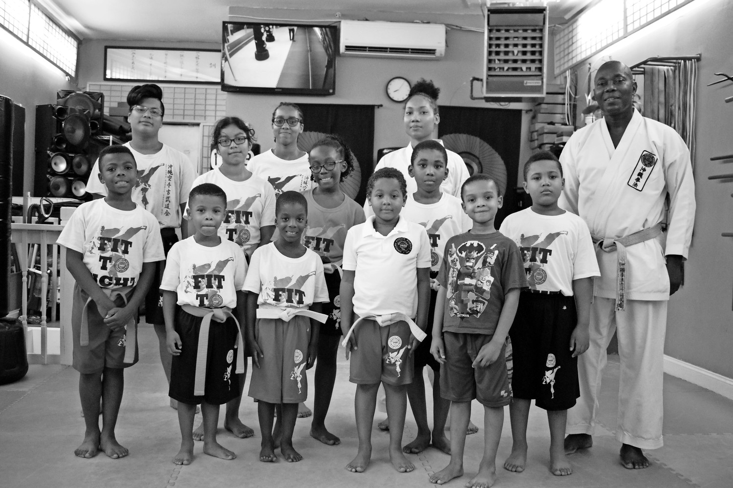 Okinawa Karate Kobudo Kai founder Serge Clark, right, teaches martial arts to children, teens and adults at his dojo on Dutch Broadway. His daughter, Joiyeux Clark, to his right, began working as an instructor at the dojo.