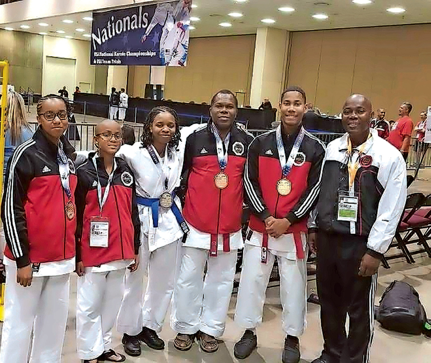 The Magic Five, from left, Jada and Anderson Lyn, Head Instructor Jessica Corbin, Assistant Instructor Jonathan Fleurant and Assistant Instructor Kohei Clark, with Sensei Serge Clark, competed in the 2018 USA National Karate Championships and Team Trials in Reno, Nev., in July.