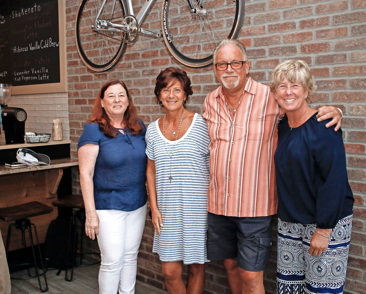 At the grand opening of Kookaburra Coffee Company in Malverne, Chamber of Commerce member Kathi Monroe, far left, owners Cindy and Michael DelGatto, and Mayor Patti McDonald celebrated the launch of the village's only coffee bar, on Hempstead Avenue, near the Long Island Rail Road station.