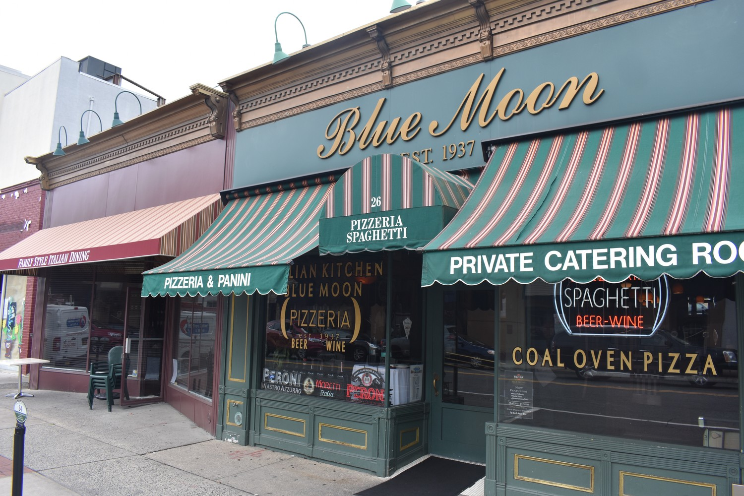 Blue Moon, a pizzeria on North Park Avenue, now has a dining room, left, offering family-style specialties.