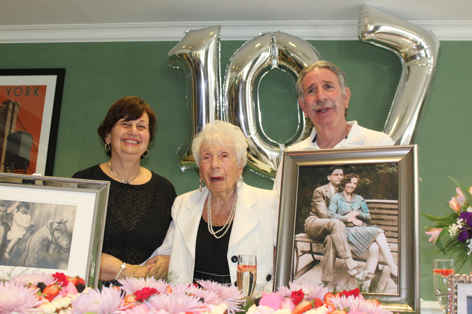 Myra Markowitz, left, and Steven Dobin celebrated their mother Henrietta's 107th birthday at the Bristal Assisted Living at North Woodmere facility on Aug. 16.