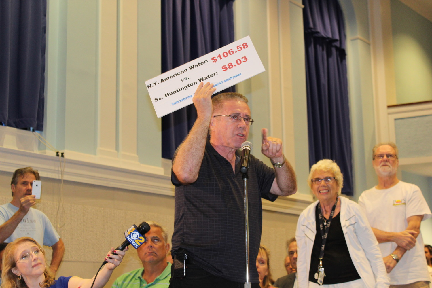 Jack McCloy, of Baldwin, protested New York American Water rate hikes during a recent town hall in East Rockaway. Those increases were temporarily halted, thanks to an agreement reached over the weekend between NYAW and the state.