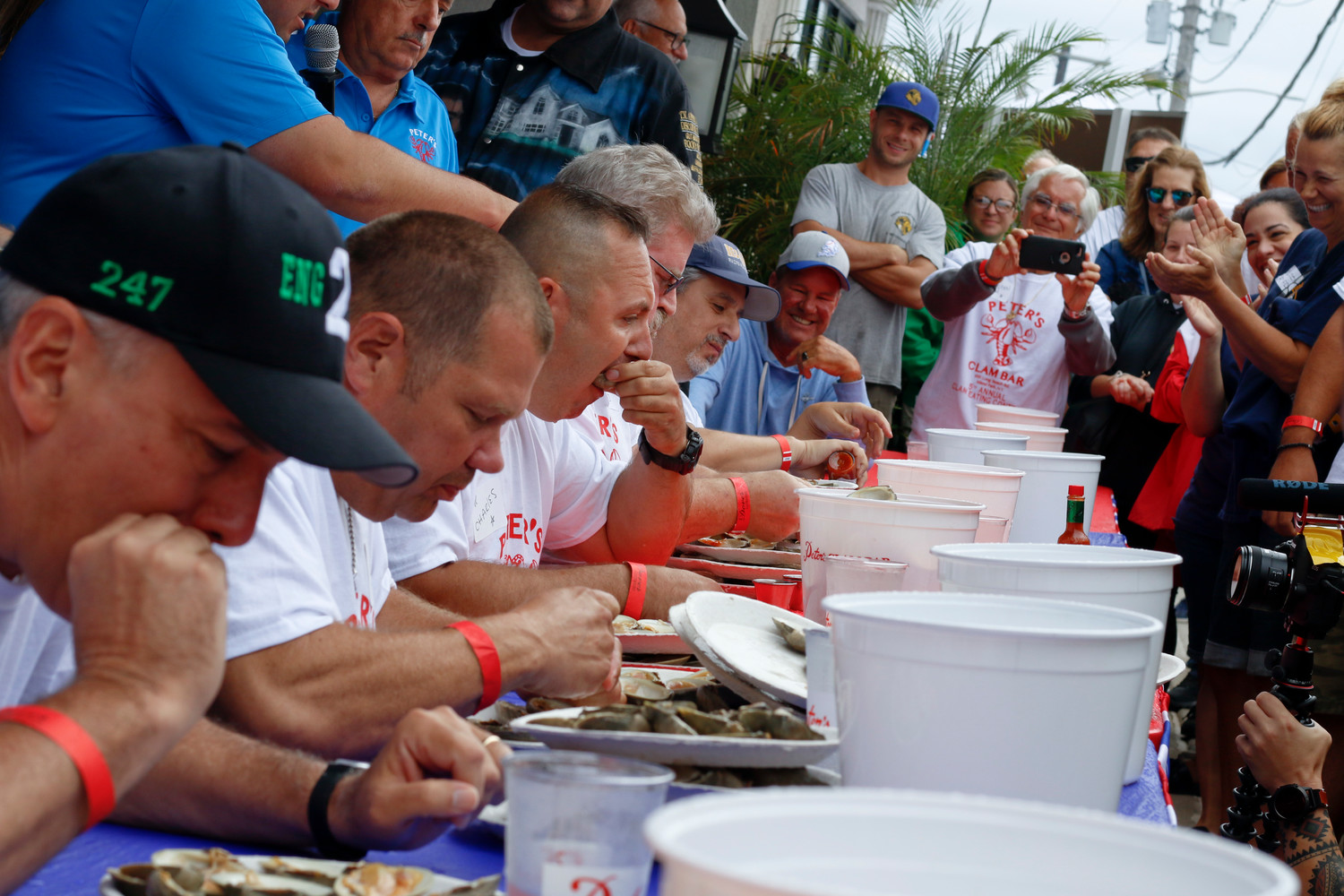 Fire Department members competed in the first heat of round one at Peter's Clam Bar clam eating contest. From left, Ken O'Connor with Lynbrook, Scott Ballard with Stewart Manor, Charles Hendry with Hempstead, Pete Adams with Island Park and Jeffrey Katz with Rockville Centre.