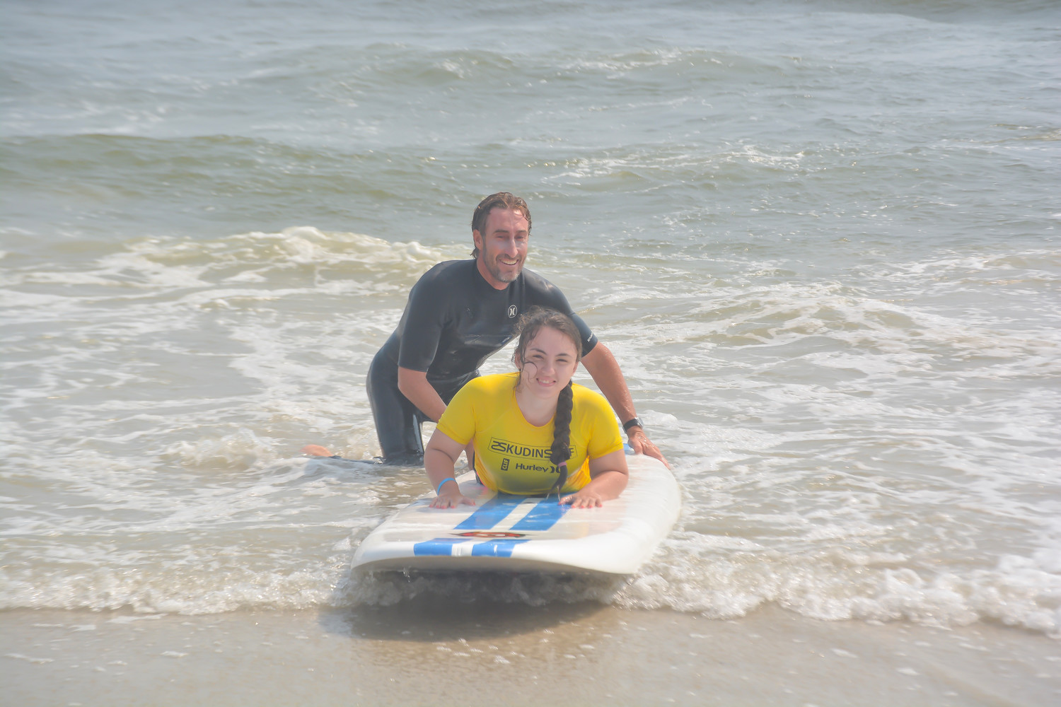 Sidorela Lleshi said she had a wonderful time surfing with the help of Skudin Surf instructor Adam Dufner during a trip to Long Beach sponsored by the Adaptive Sports Academy at the Hospital for Special Surgery on Aug. 15.