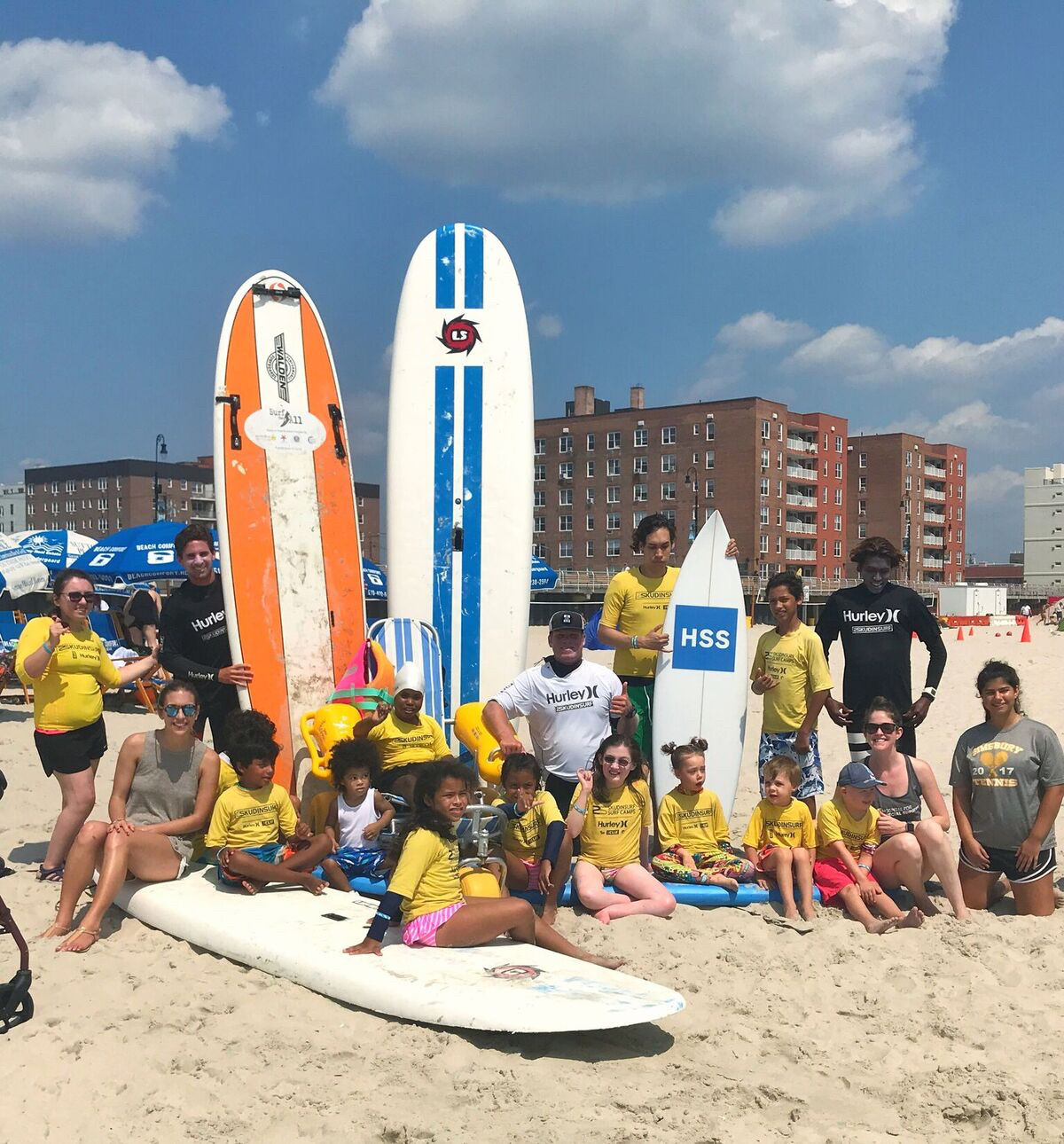 A group of patients from the Hospital for Special Surgery teamed up with Long Beach surf instructors from Skudin Surf for a day of fun.