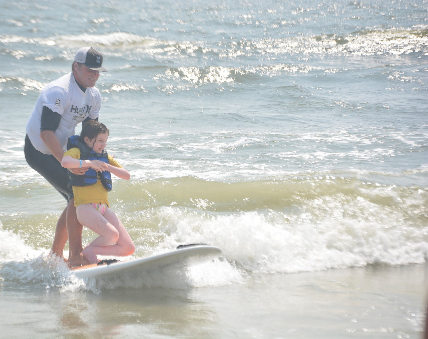 Teadora Wollemberg experienced the thrill of surfing with instructor Cliff Skudin.