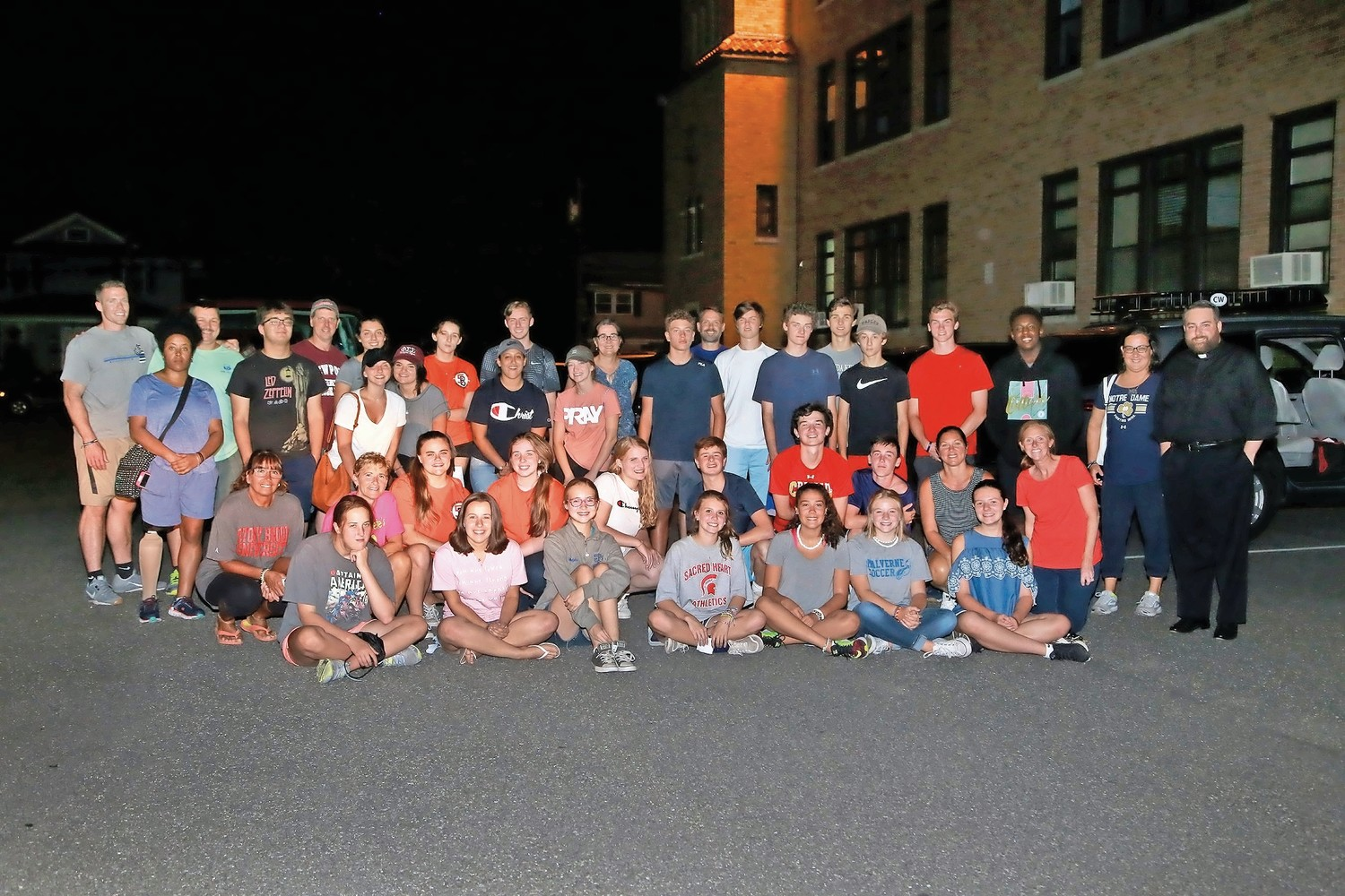 Midnight Run volunteers from Our Lady of Lourdes Youth Ministry made their way into the city on Aug. 9.
