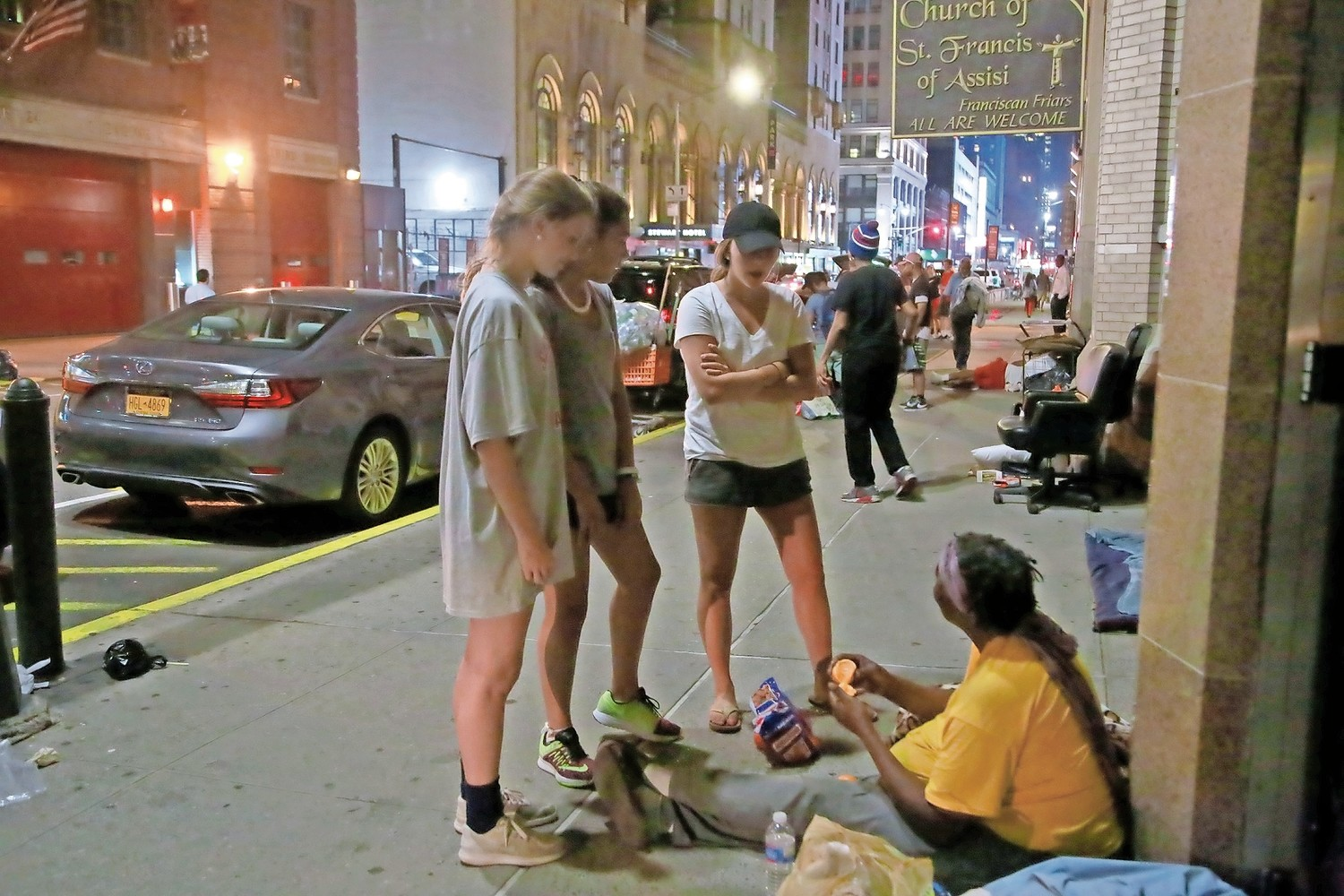 Linda Freel, left, Sydney Aviles and Erin Freehill met with a homeless woman in the city.