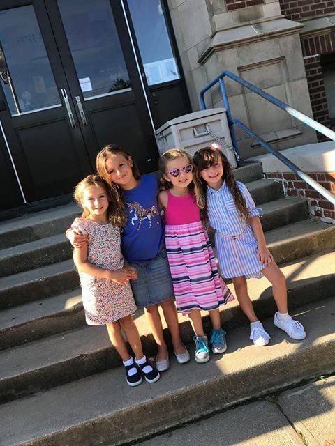 Kindergartener Brooke, left, with second-graders Ava, Payten and  Amiya at Centre Avenue.