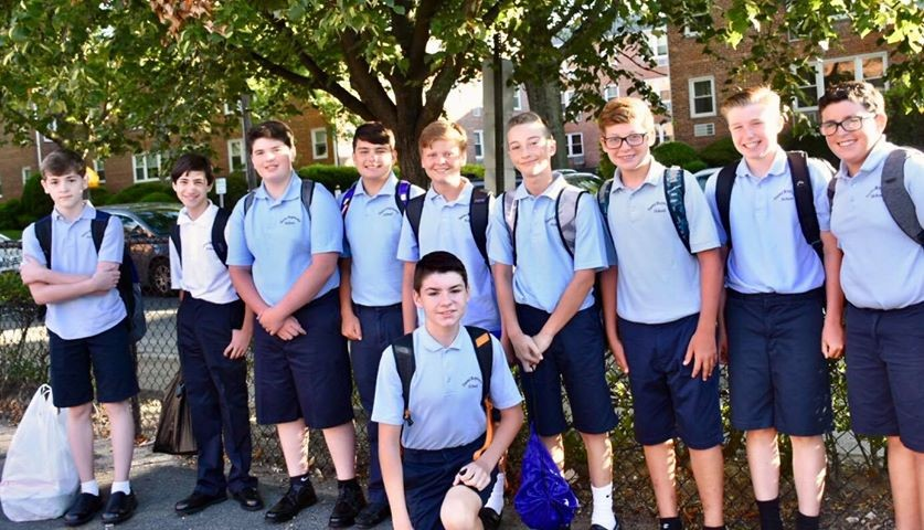 Eighth grade boys took some time outside before starting the new year at St. Raymond's.