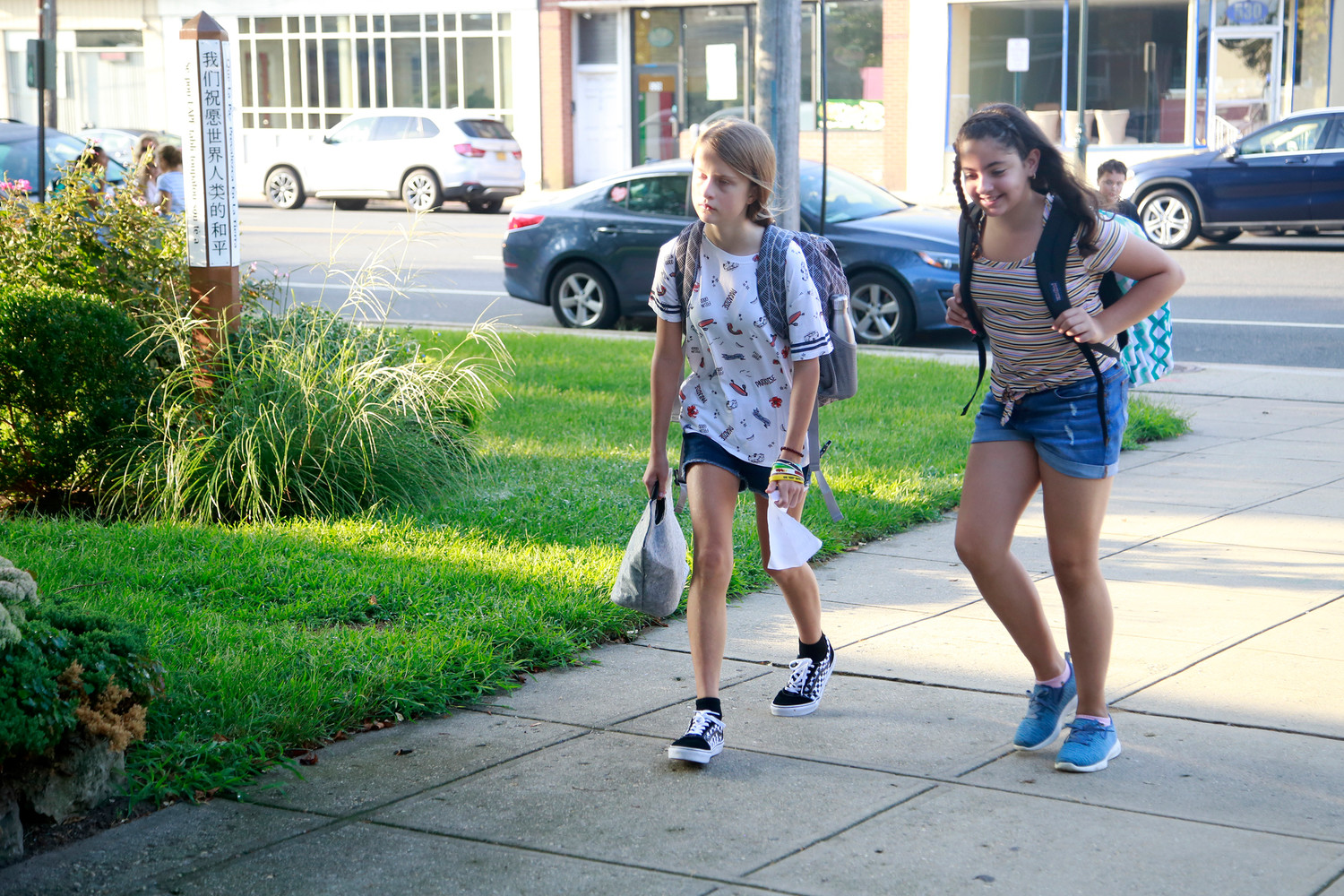 It was mixed emotions for sixth-graders Chloe Brown, left, and Bobbie Applebaum as they arrived at Lynbrook North Middle School for the first time.
