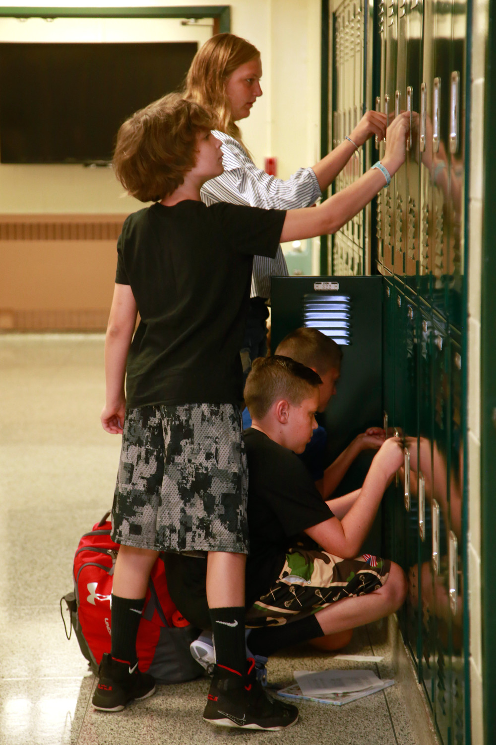 Alex Kopper, Chris Lamoreaux, Ryan Kehoe and Stephanie Neri tried out their new lockers at Lynbrook North Middle School.