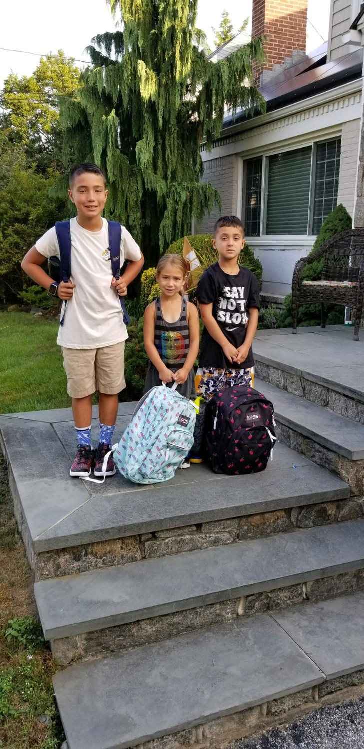 Kaden Rogers, left, Caroline Rogers and Max Rogers before starting school. Kaden and Max were off to Marion Street, while Caroline attended the Lynbrook Kindergarten Center.