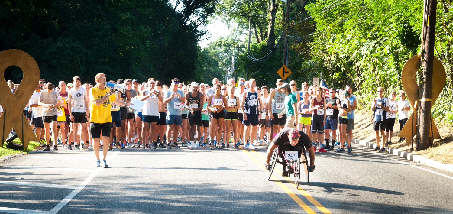 Pete Hawkins, the only wheelchair racer to compete, top, led the crowd in the main race.