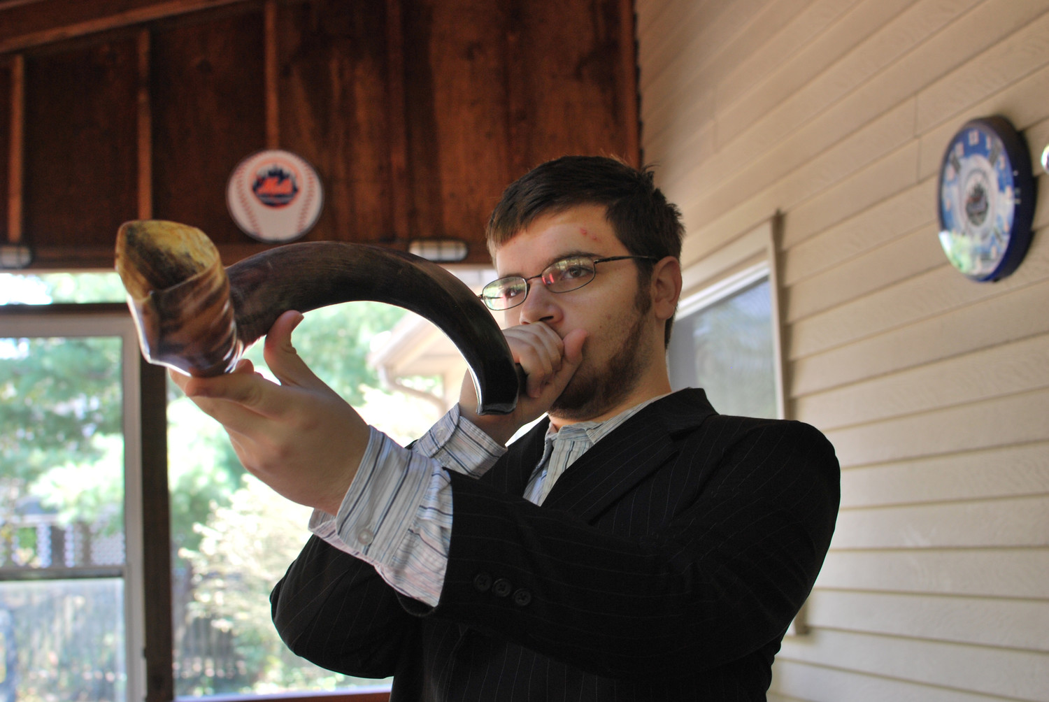 Man blowing a shofar, or ram's horn, on Rosh Hashanah