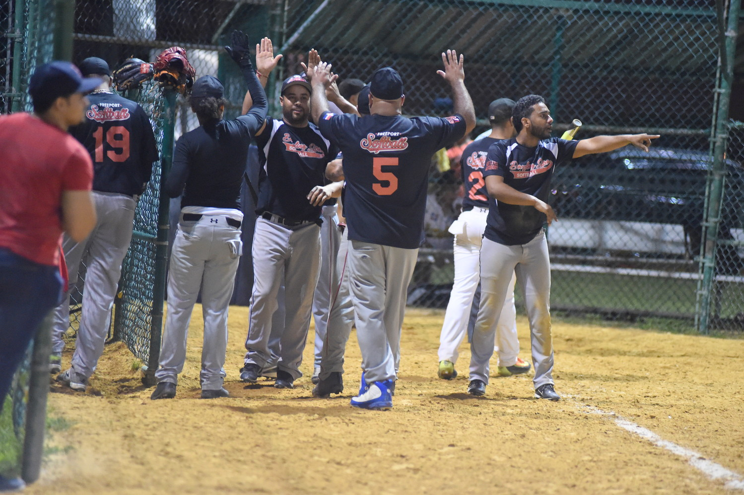 After a win over Metro West Water, Dazzling Spa players cheered and congratulated one another at Randall Park in Freeport last month.
