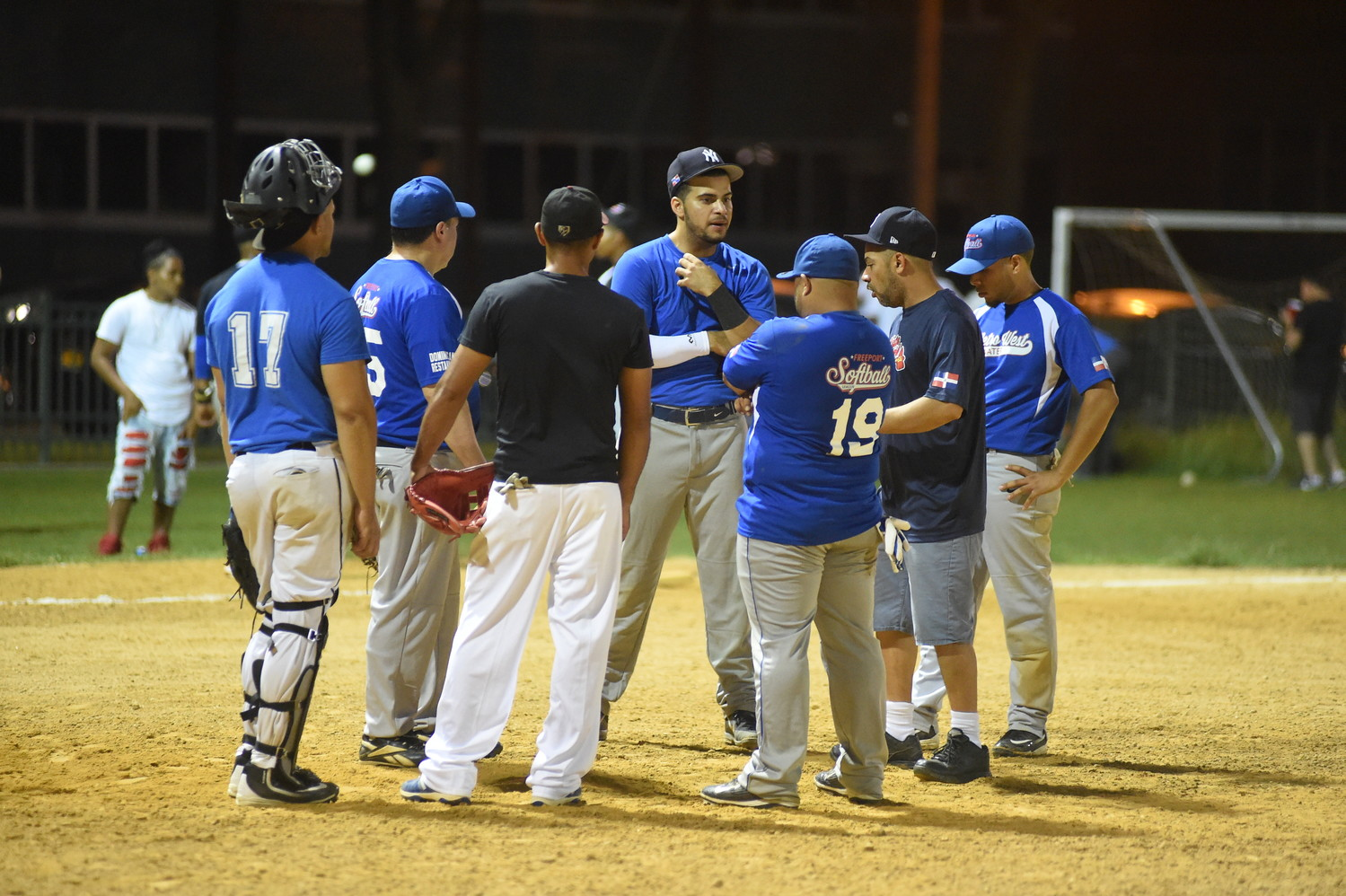Players for Metro West Water and Dazzling Spa reviewed whether a ball was foul during a recent game.