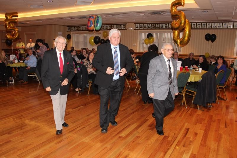 Thomas McGovern, far left, Edward Irving and Frank Giannone were honored for their years of service to the Bellmore Fire Department in 2016.