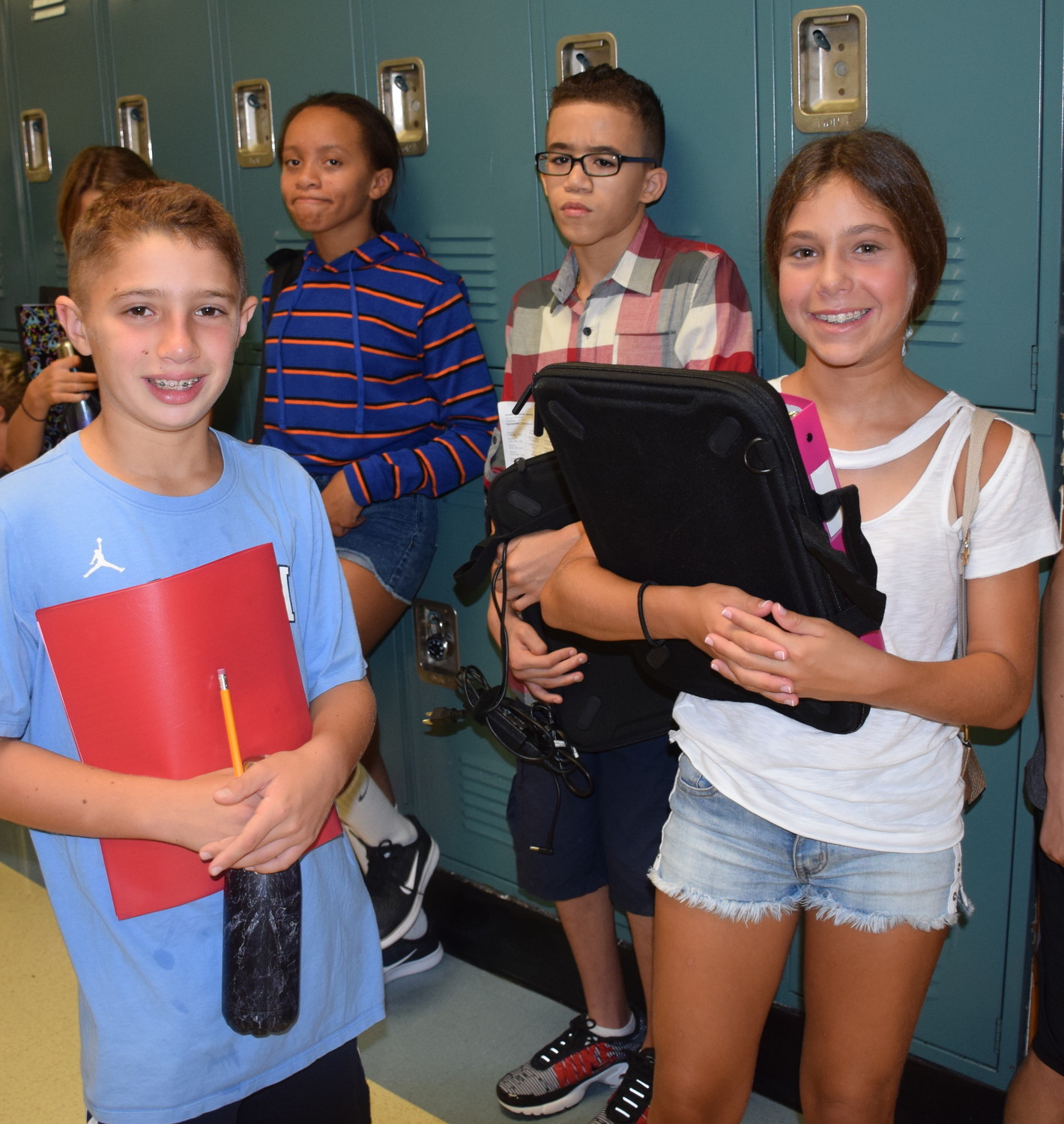 Jack Schare, Sklya Cooper, Jaeven Vasquez and Mia Schack on their first day back at Long Beach Middle School.