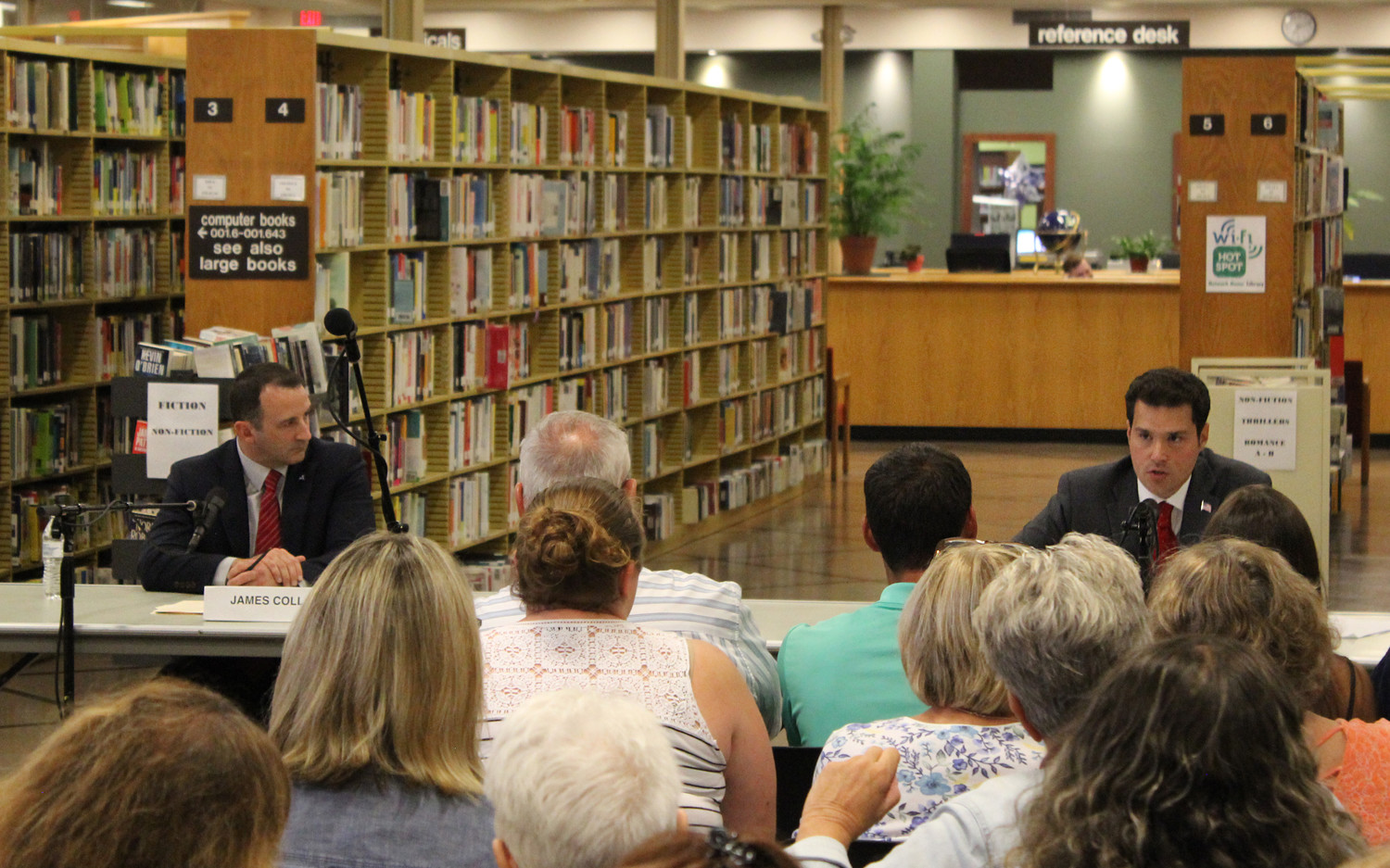 John Mikulin and James Coll, both Republican candidates for the State Assembly's 17th District, sparred at a public forum at the East Meadow Public Library, sponsored by the Nassau County League of Women Voters, on Aug. 29.
