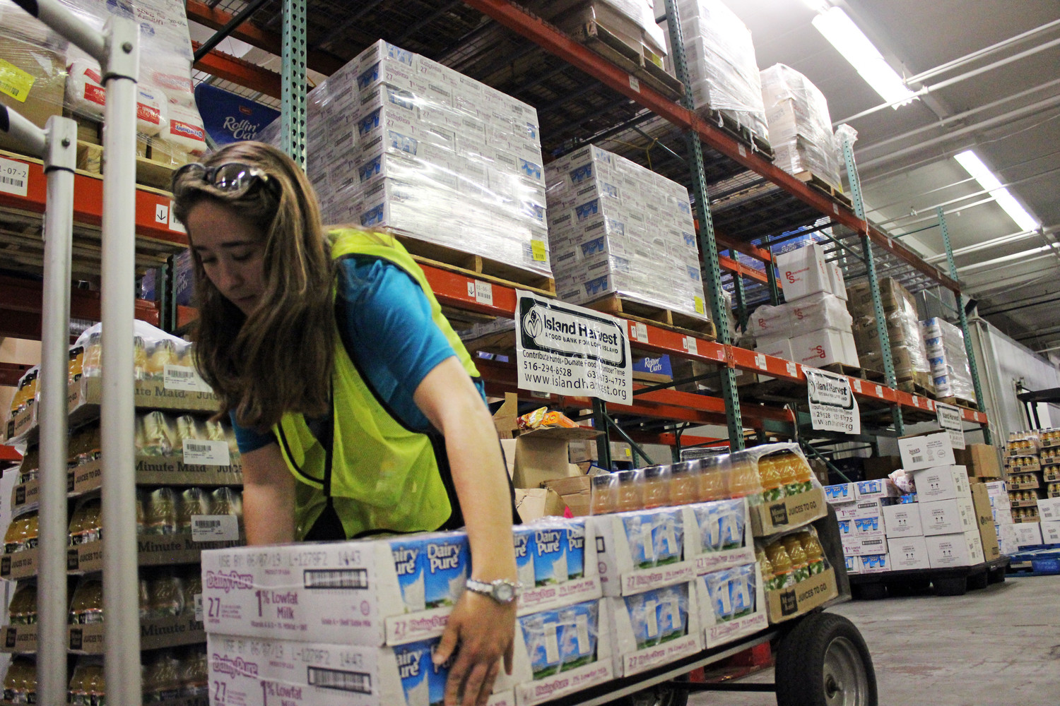Island Harvest Food Bank and Jovia Financial Credit Union — formally NEFCU — will be providing meals to hundreds of affected by the Covid-19 pandemic. Above, Noelle Roth, was interning at Island Harvest and gathering food to distribute to students.