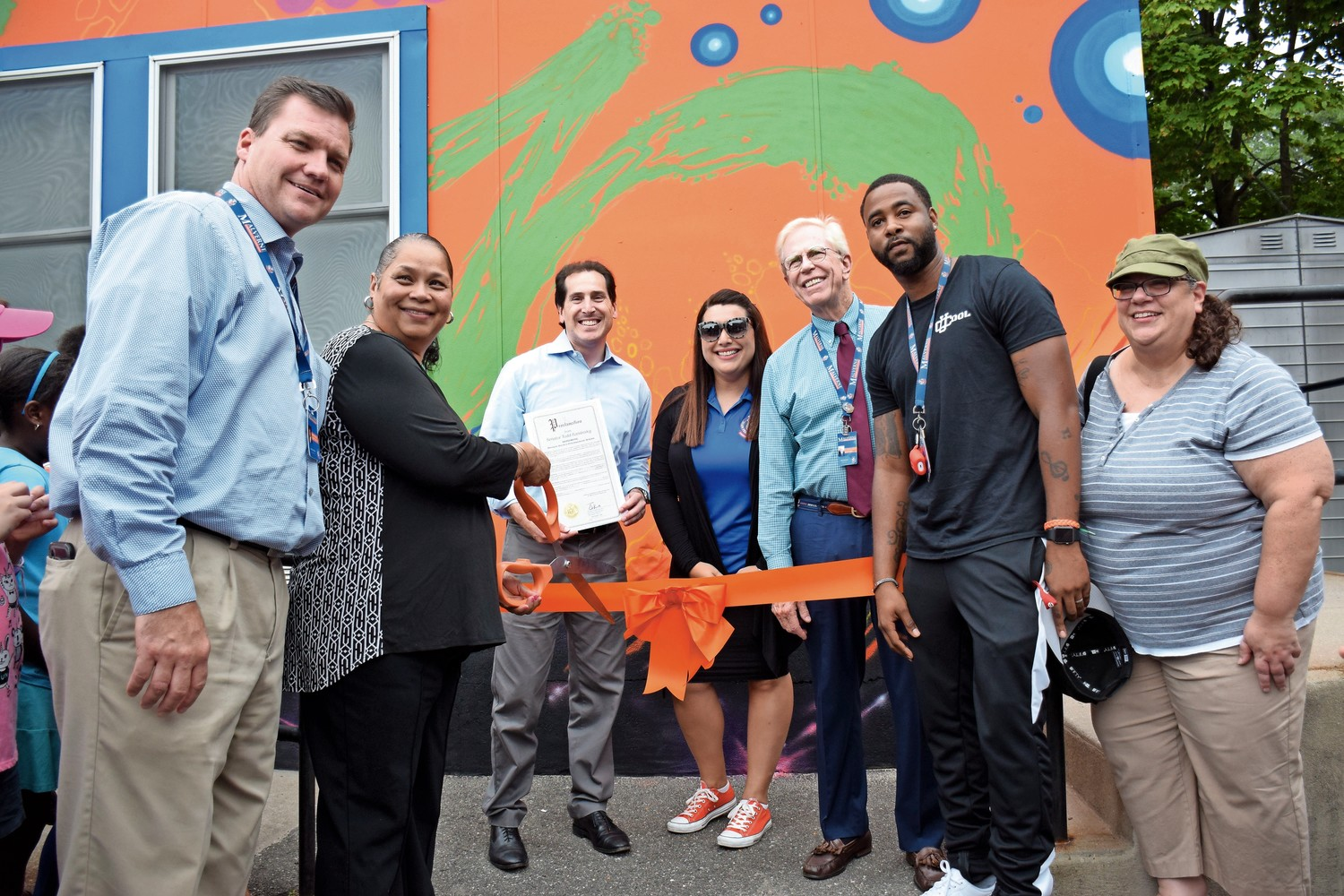 District members Steven Gilhuley, left, Phyllis Tinsley, State Sen. Senator Todd Kaminsky, Principal Rachel Gross, Superintendent James Hunderfund, teacher Nick Alleva and Board President Jeanne D'Esposito at the ribbon-cutting ceremony for Explore Zone.