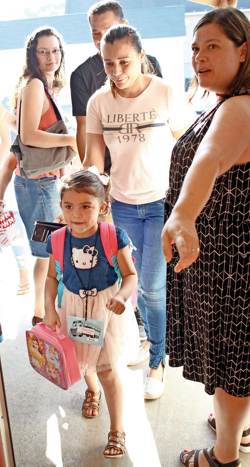 "Camila Rivera said, ""Hello,"" to Principal Faith Tripp during her first day of school."