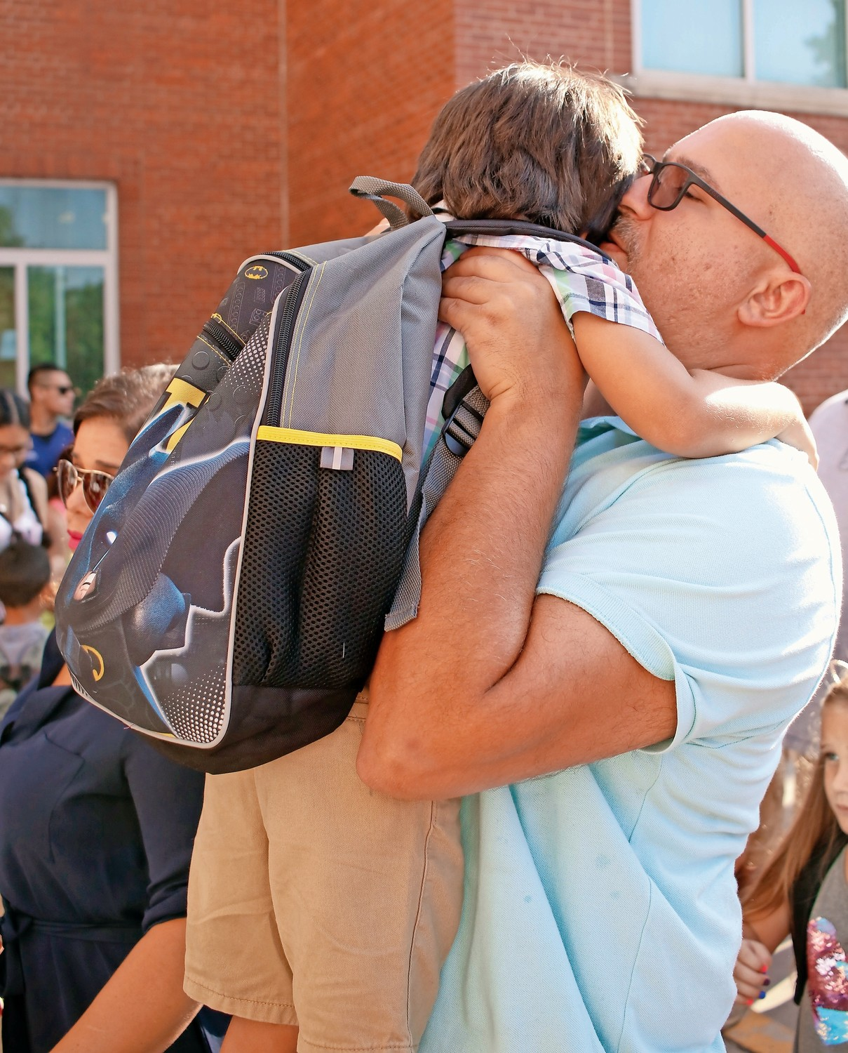 Cristian Irizarry gave his father, John, a hug before heading inside.