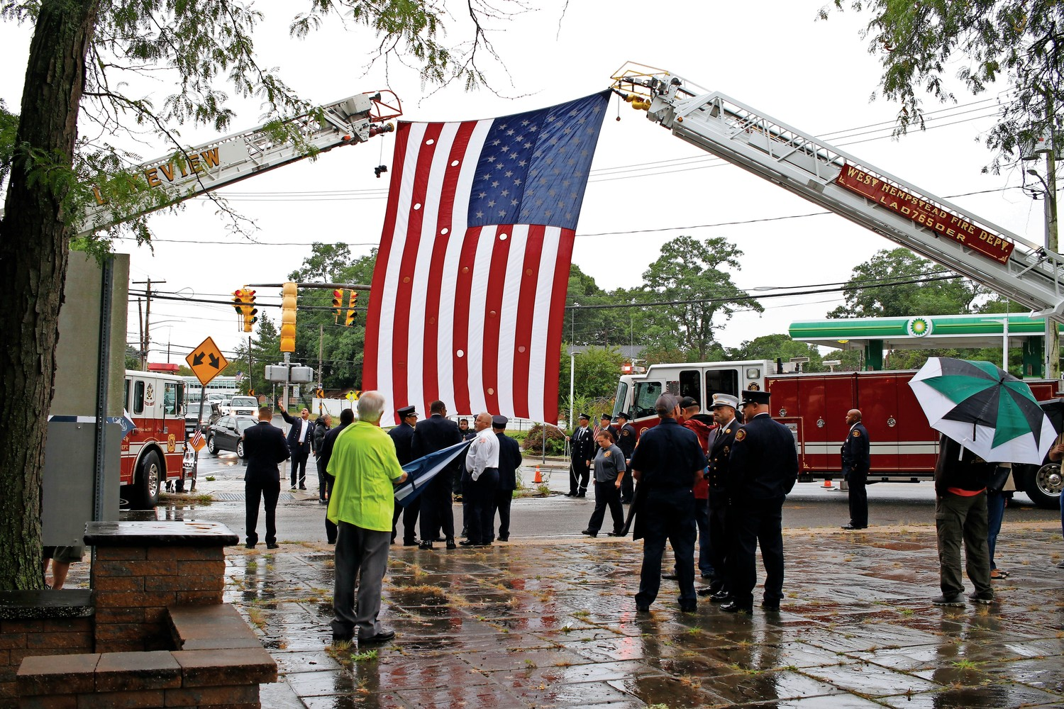 West Hempstead and Lakeview Fire Departments lifted a flag into the sky before the ceremony began.