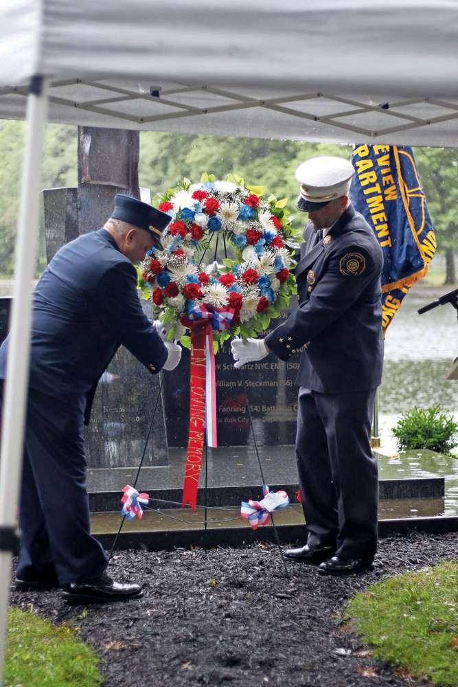 Chiefs from both departments Sal Sinatro with Lakeview and Peter Lilli with West Hempstead placed the wreath at the memorial.