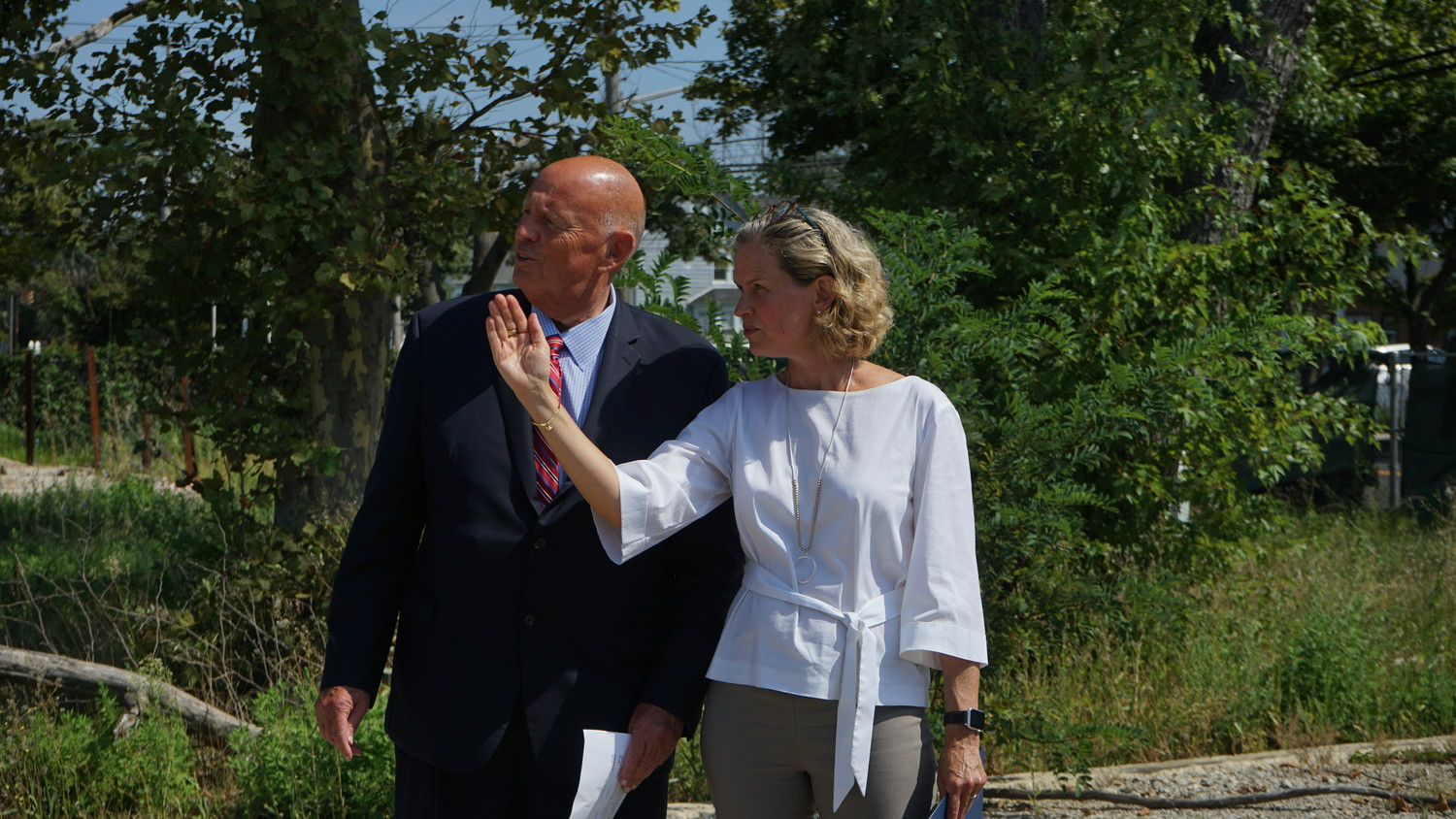 County Executive Laura Curran and Nassau County Industrial Development Agency Chairman Richard Kessel at the site of the proposed apartment development in Oceanside. The two lauded the project as potentially bringing a younger generation of renters to the area, though some residents are concerned about traffic.