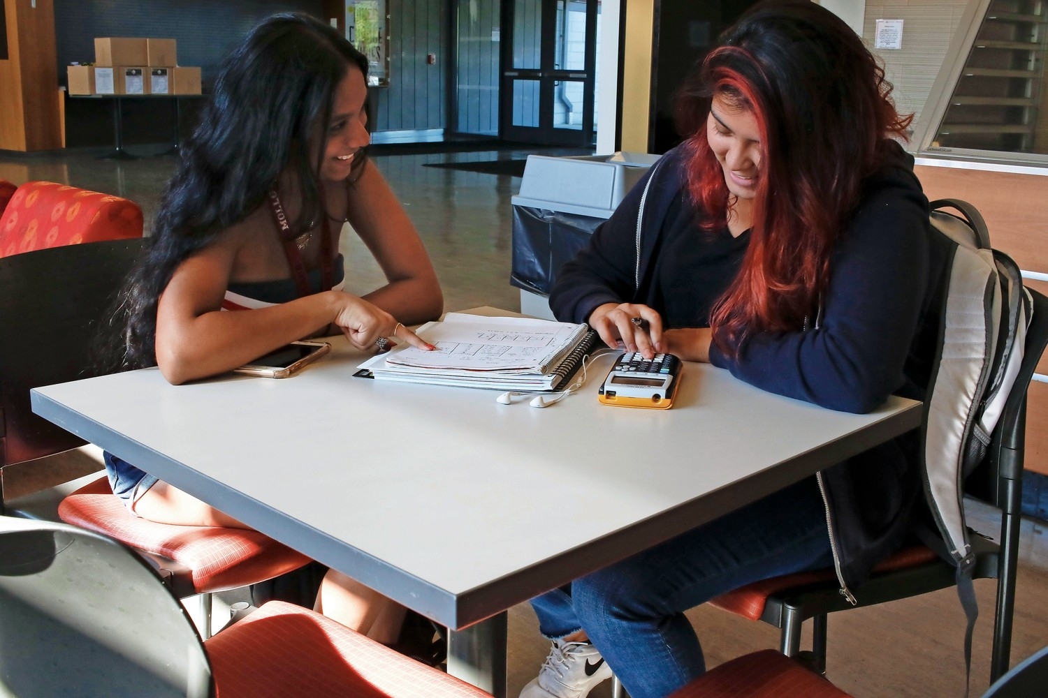 Freshmen Britney Singh, left, and Samantha Adams, of New Hyde Park, chose Molloy College for its inviting feel and for its double major offer, respectively. Singh is majoring in psychology and Adams is double majoring in psychology and criminal justice.