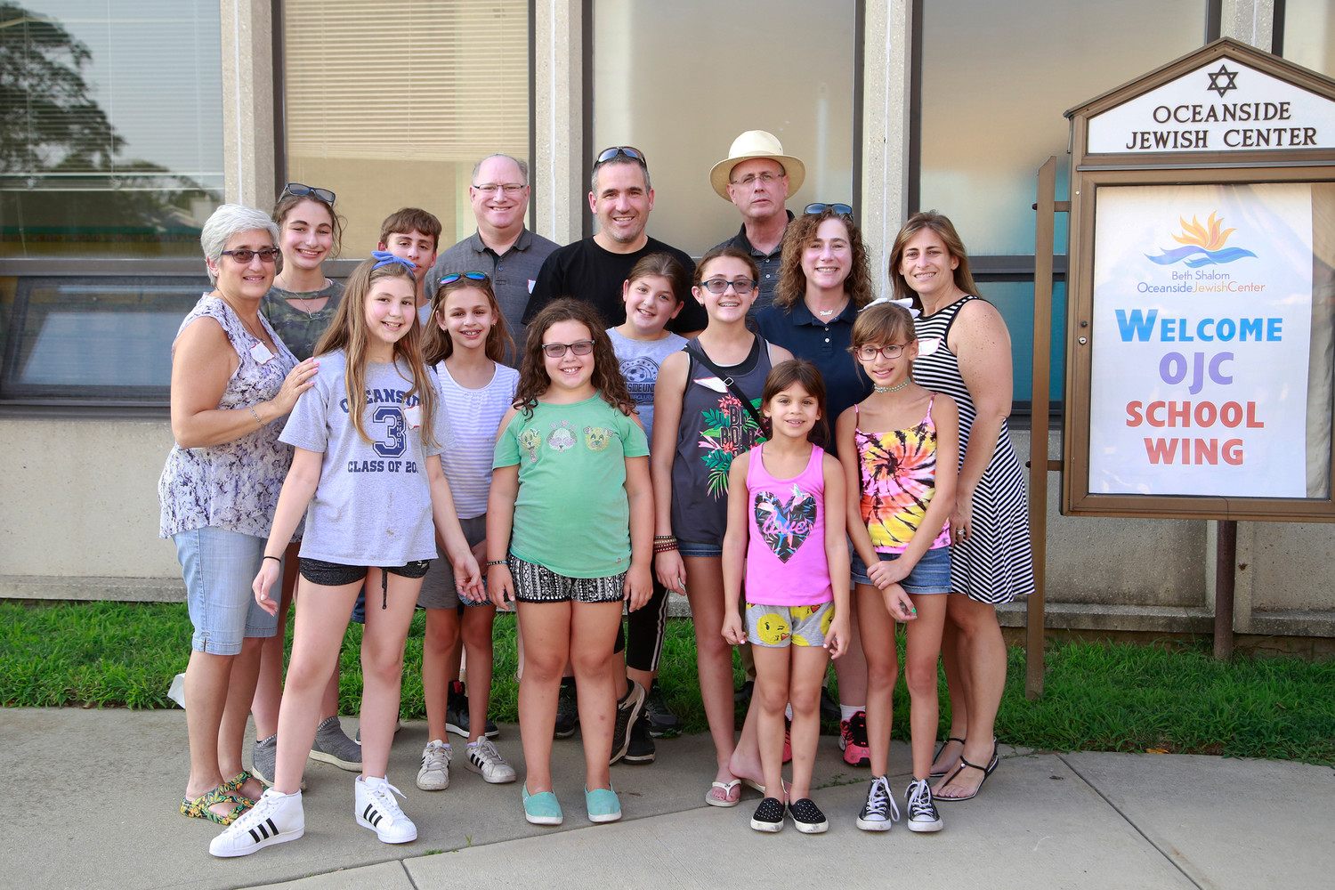 The Oceanside Jewish Center's executive board along with a handful of children at the center's Welcome Back BBQ on Aug. 23.