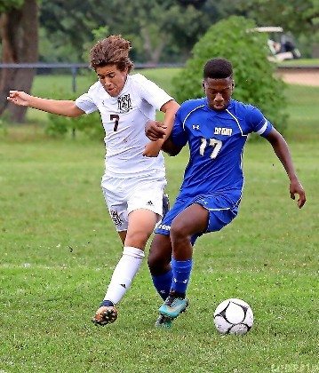 East Meadow's Samuel Nkrumah, right, fended off Clarke's Jayden Gomez-Aguedelo in last Saturday's non-conference game between the locals. The Jets won, 5-2.