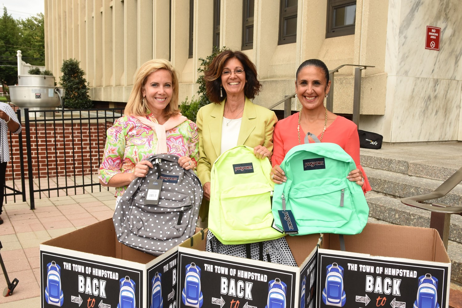 Hempstead Town Supervisor Laura Gillen (left), President and CEO of Island Harvest Food Bank Randi Shubin Dresner (middle), Town Clerk Sylvia Cabana (right) hope to collect 700 new backpacks for the Town of Hempstead's Kids Weekend Backpack Collection Drive.